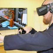 James Ridley using Virtual Reality software for IS machine training