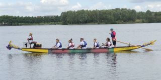 Brewster Partners come 6th in annual Dragon Boat race